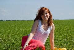 Beautiful girl rest on the green Stock Image