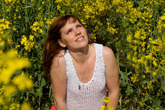 Beautiful girl rest on rapeseed field Royalty Free Stock Photography