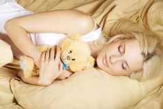 A beautiful girl resting on the bed Stock Photography