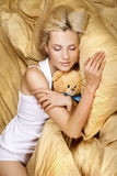 A beautiful girl resting on the bed. Pretty happy girl on the bed at home Royalty Free Stock Photography