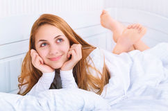 Beautiful girl resting on the bed Stock Photo