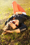 beautiful girl resting on the grass Stock Photos