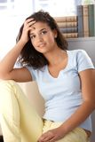 Beautiful girl resting at home smiling Stock Photos