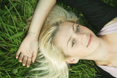 Beautiful girl resting in park Royalty Free Stock Photography