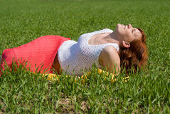 Beautiful girl rests in the meadow Stock Photos