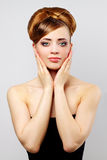 Beautiful girl with retro hairstyle on gray Royalty Free Stock Photography