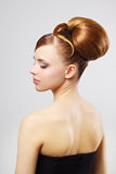 Beautiful girl with retro hairstyle on gray Stock Photography