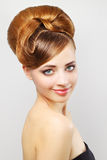 Beautiful girl with retro hairstyle on gray Royalty Free Stock Photo