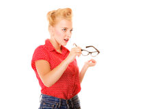 Beautiful girl retro hairstyle holds glasses isolated Stock Images