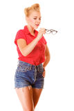 Beautiful girl retro hairstyle holds glasses isolated Royalty Free Stock Images