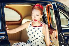 Beautiful girl in retro style and a vintage car. Close-up royalty free stock photos