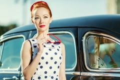 Beautiful girl in retro style and a vintage car. Close-up stock image