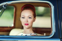 Beautiful girl in retro style and a vintage car. Close-up stock photo