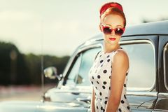 Beautiful girl in retro style and a vintage car. Close-up, nice lady royalty free stock photo
