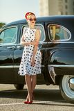 Beautiful girl in retro style and a vintage car. Nice lady Royalty Free Stock Images