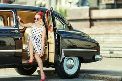 Beautiful girl in retro style and a vintage car. Nice lady Royalty Free Stock Photography