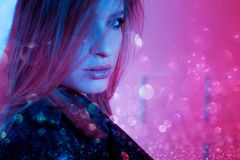 Beautiful girl in retro wave on the neon light. Portrait with double exposure effect. royalty free stock images