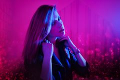 Beautiful girl in retro wave on the neon light. Portrait with double exposure effect. stock images