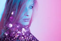 Beautiful girl in retro wave on the neon light. Portrait with double exposure effect. royalty free stock photo