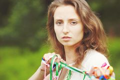 Beautiful girl with ribbons Royalty Free Stock Photography