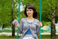 Beautiful girl ride on a swing Stock Photography