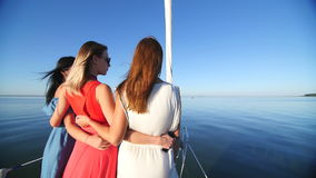 Beautiful girl ride on a yacht - party and bachelorette party.  stock video