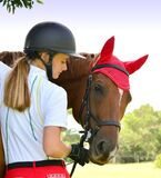 Beautiful girl rider interacting with her horse