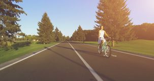 Beautiful girl rides on the vintage bike. 4k, 25 fps stock video footage