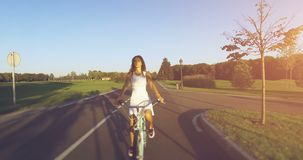 Beautiful girl rides on the vintage bike. 4k, 25 fps stock footage