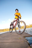 Beautiful girl riding bicycle Royalty Free Stock Images