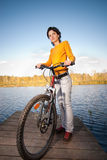 Beautiful girl riding bicycle Royalty Free Stock Photography