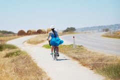 Beautiful girl riding bicycle Stock Photography