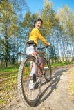 Beautiful girl riding bicycle Stock Image