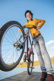 Beautiful girl riding bicycle Stock Images