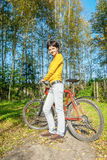Beautiful girl riding bicycle Royalty Free Stock Photos