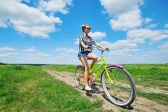 Beautiful girl riding bicycle Royalty Free Stock Photos