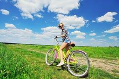 Beautiful girl riding bicycle outdoors Stock Photos
