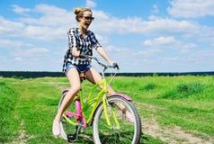 Beautiful girl riding bicycle outdoors Stock Photo