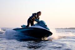 Beautiful Girl Riding Her Jet Skis Royalty Free Stock Image