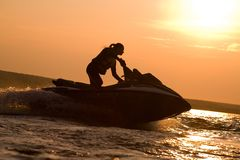 Beautiful girl riding her jet skis Royalty Free Stock Photo