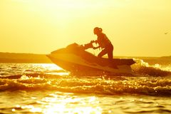 Beautiful girl riding her jet skis Royalty Free Stock Images