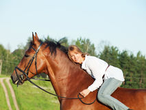 Beautiful  girl  riding on horse Stock Photo