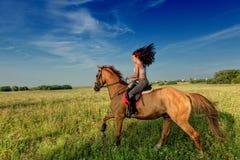 Beautiful girl riding a horse Royalty Free Stock Photos