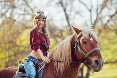 Beautiful girl riding horse on autumn field Royalty Free Stock Photo