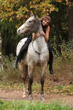 Beautiful girl riding a horse without bridle or saddle Royalty Free Stock Photography