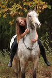 Beautiful girl riding a horse without bridle or saddle Stock Image