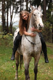 Beautiful girl riding a horse without bridle or saddle Stock Photo