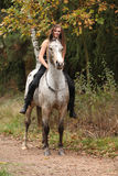 Beautiful girl riding a horse without bridle or saddle Royalty Free Stock Photos