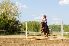 Beautiful girl riding a  purebred horse Stock Photo