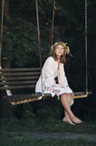 Beautiful girl riding on swing Royalty Free Stock Photos